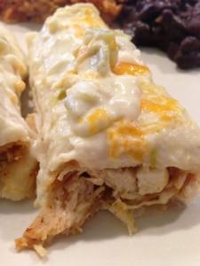 chicken enchiladas with a flavorful sour cream sauce on top