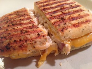 cheesy tuna mixture inside of Italian bread toasted and served as a panini