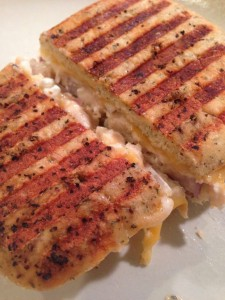 crunchy bread with a tasty tuna mixture served as a panini